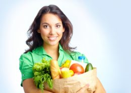 Portrait of pretty girl with big paper sack full of different fruits and vegetables